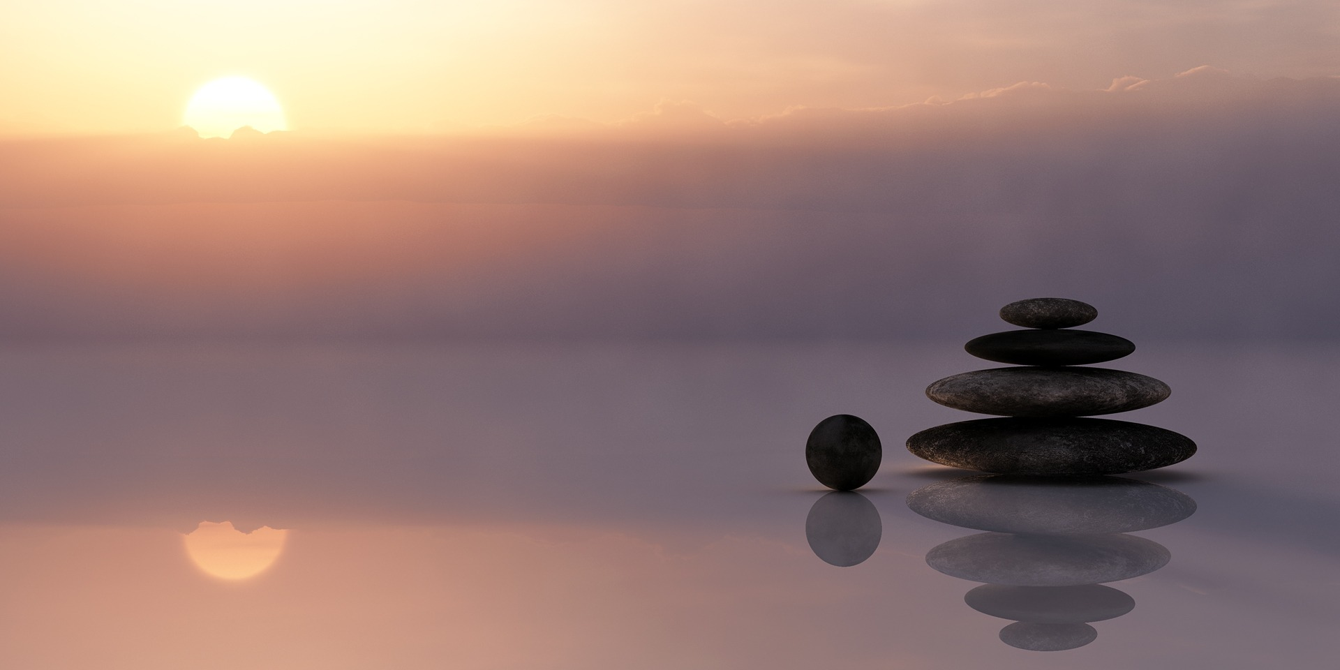 Balancing stones on clear waters